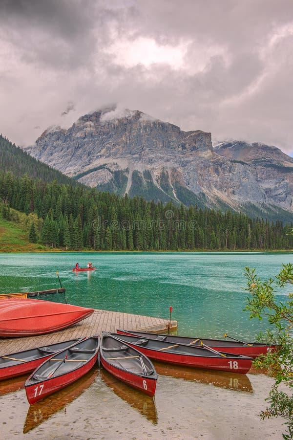 Boating on Emerald lake during the rain.Yoho National Park.British Columbia.Canada stock photography