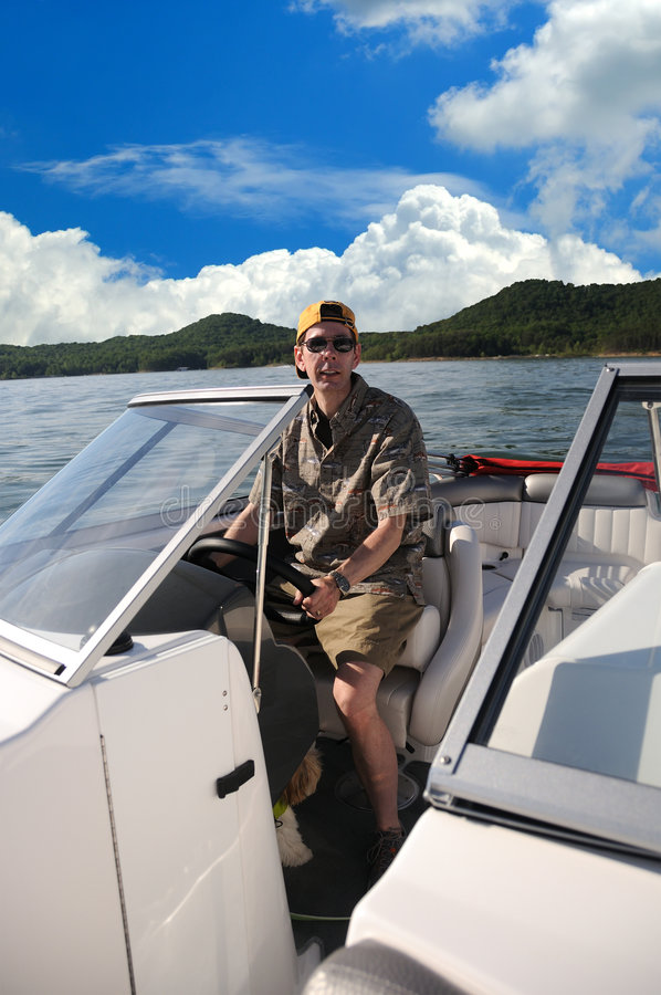 Boating In Kentucky. Captain sitting at the helm while boating on Cave Run Lake in Kentucky, USA royalty free stock images