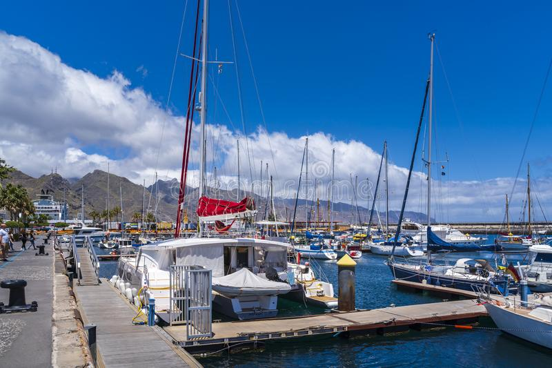 Boating port with larger sailboats lying in front of Santa Cruz de Tenerife royalty free stock photography