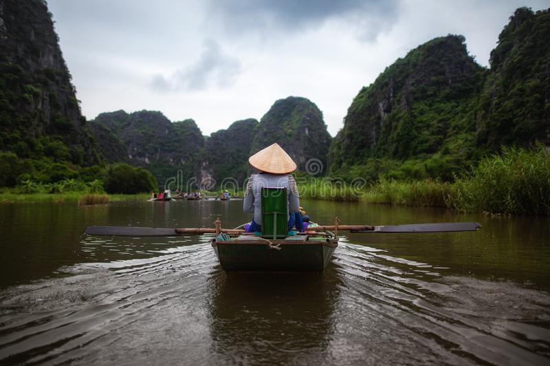 Boating on river, way to Trang An Scenic Landscape in Ninh Binh, Vietnam stock images