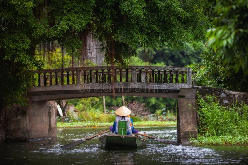 Boating on river, way to Trang An Scenic Landscape in Ninh Binh, Vietnam stock photography