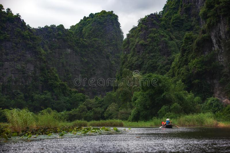 Boating on river, way to Trang An Scenic Landscape in Ninh Binh, Vietnam royalty free stock image