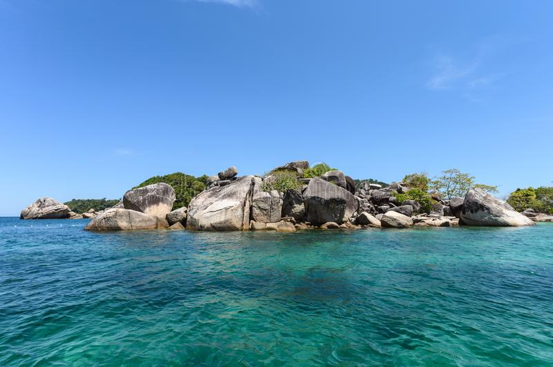 Boating sightseeing with big rocks natural stacked in tropical sea at lipe. Island stock photo