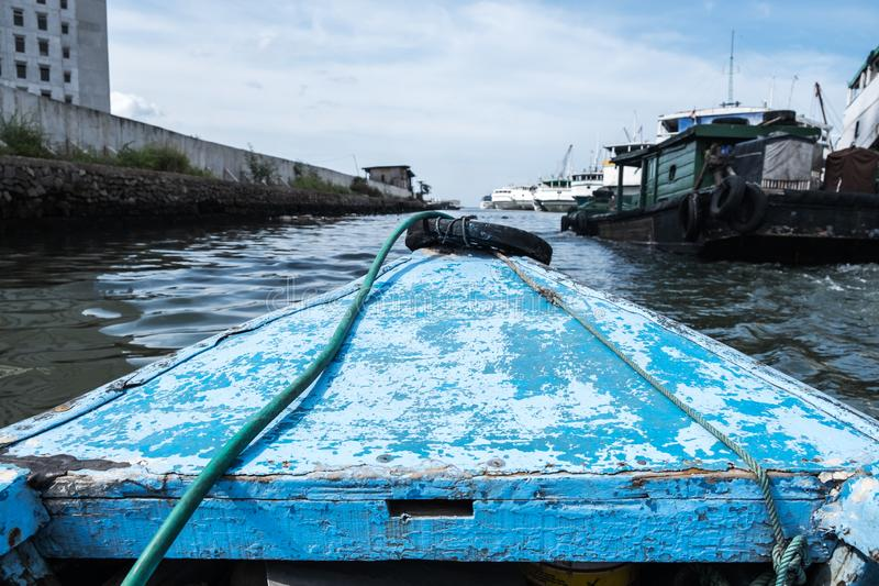 View of Boating with small wooden ship along in Sunda Kelapa Port, Jakarta for the vacation leisure. Boating with small wooden ship along in Sunda Kelapa Port royalty free stock images