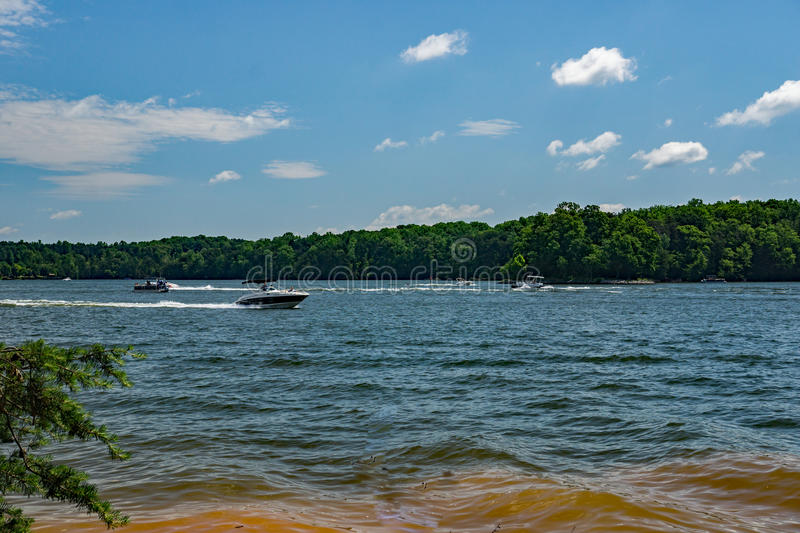 Boating on Smith Mountain Lake. Franklin County, VA – May 29tht: View of boaters enjoying the day on Smith Mountain Lake from in Smith Mountain Lake royalty free stock images