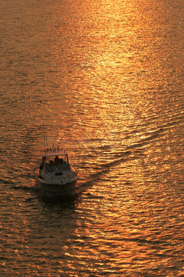 Download Boating at sunset stock photo. Image of wake, retirement - 922460