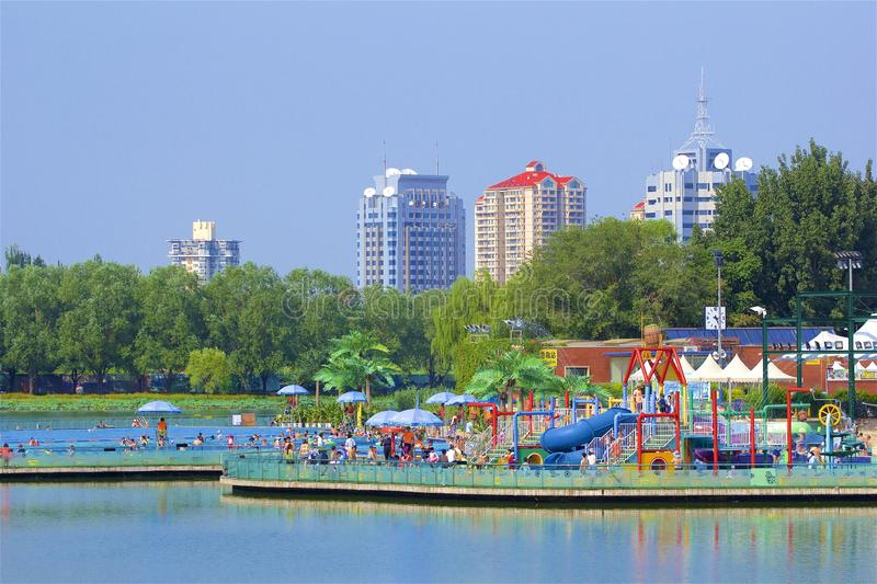 Swimming pool and beach in Chaoyang park, Beijing. Boating and views in Chaoyang park, Beijing, China stock photo