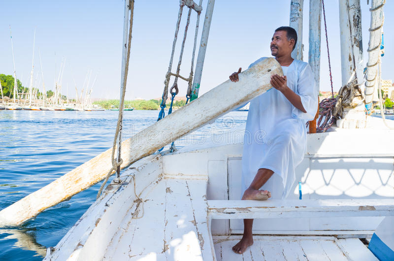 The boatman. ASWAN, EGYPT - OCTOBER 6, 2014: The boatman on his felucca, on October 6 in Aswan royalty free stock photography