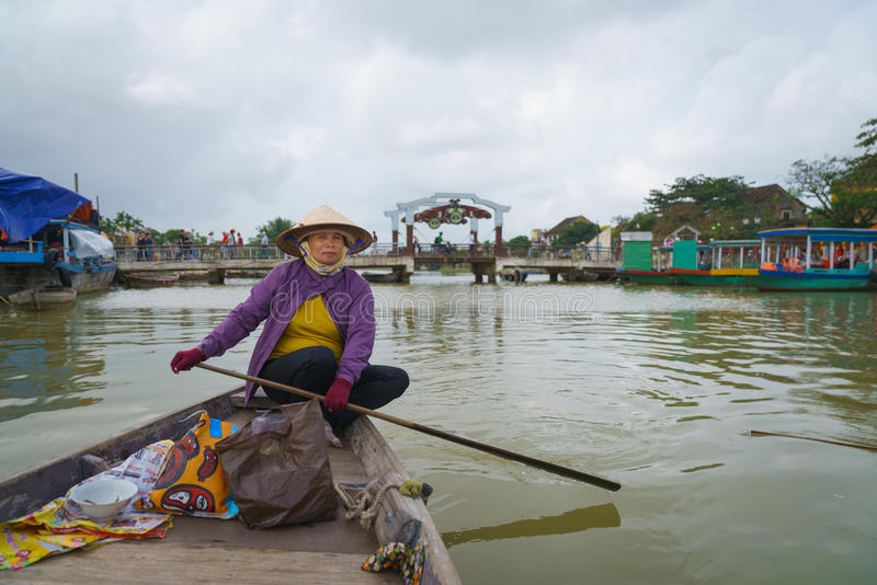 Boatman with Conical hats in Vietnam. Taken in Hoi an ancient town, Danang. Photo taken on: January 10th, 2017 stock photography