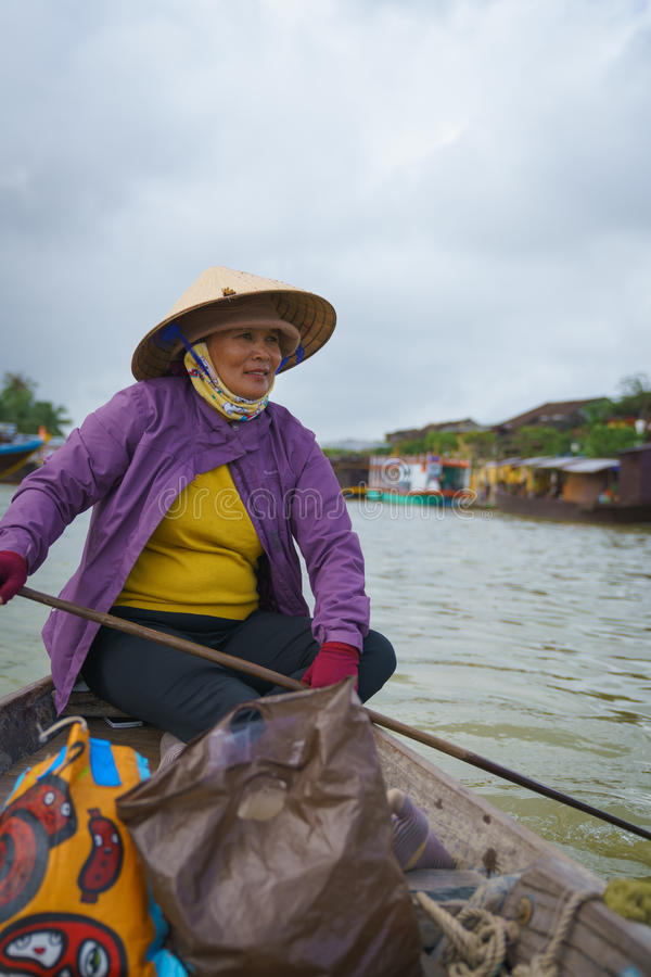 Boatman with Conical hats in Vietnam. Taken in Hoi an ancient town, Danang. Photo taken on: January 10th, 2017 stock photo