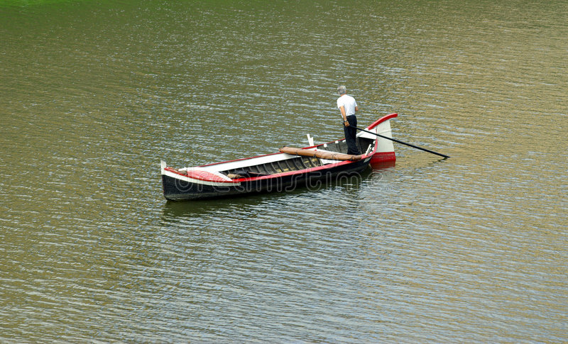 Boatman in Italy. Boatman on Arno River in Florence (Firenze), Italy royalty free stock images