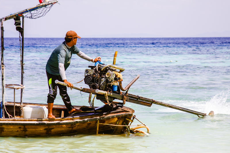 Boatman. Boatman move the boat position to go towards new horizons. Barca located in southern Thailand stock images