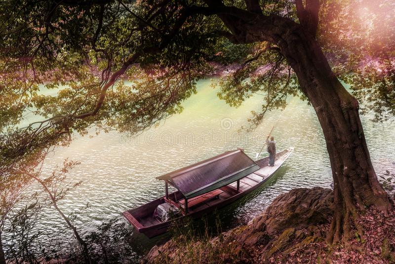 Boatman punting the boat at river in Japan.  royalty free stock photography