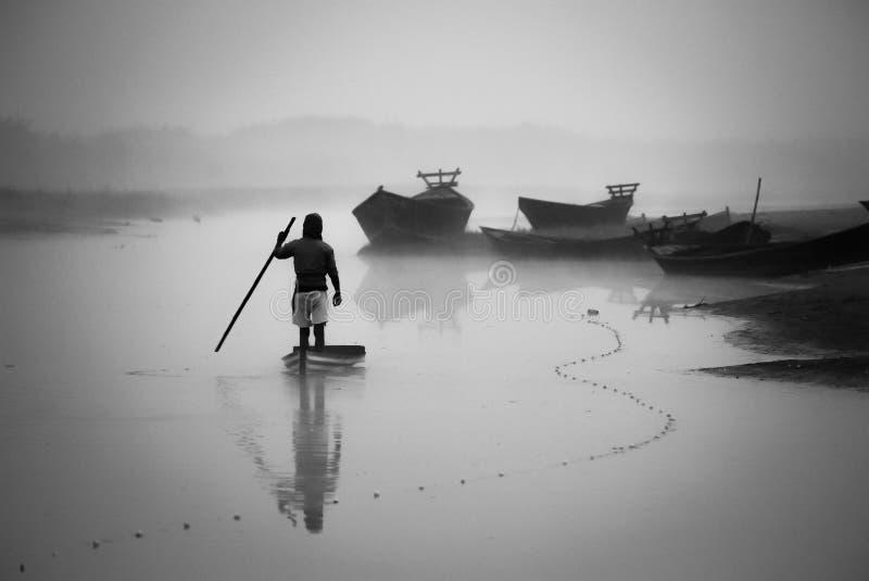 The boatman. A boatman on the river stock photo
