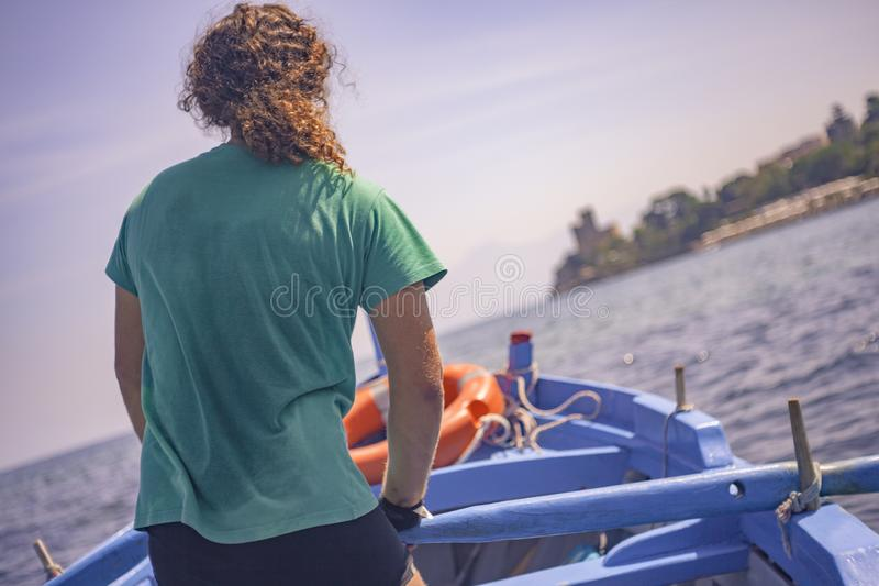 Boatman rows  2. Boatman paddles in his wooden boat during a sunny afternoon royalty free stock photography