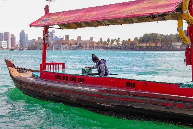 Boatman in a sea. A boatman sailing a tourism boat stock images
