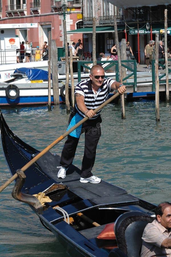 Boatman in venice. VENICE, ITALY - Jul 06, 2008: boatman in venice middle aged tourists stock photos