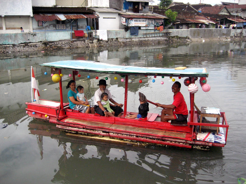 Boatman. Waiting passengers will cross the river in the city of Solo, Central Java, Indonesia royalty free stock images