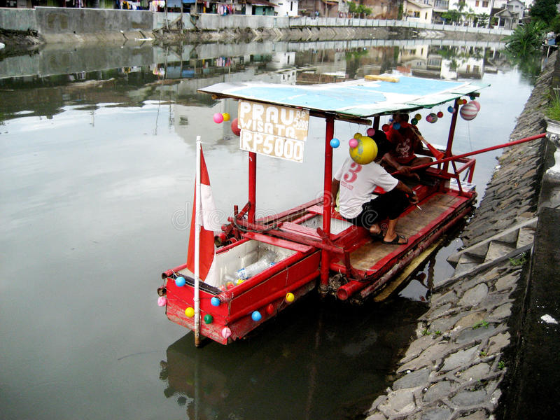 Boatman. Waiting passengers will cross the river in the city of Solo, Central Java, Indonesia royalty free stock photo