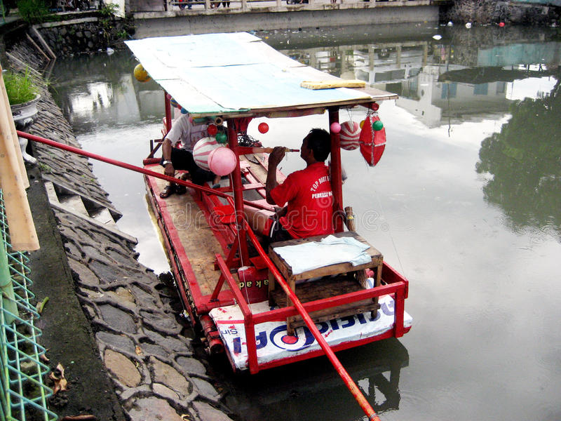 Boatman. Waiting passengers will cross the river in the city of Solo, Central Java, Indonesia stock photo