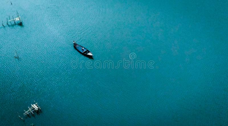Boatman on river. A boatman was carrying a passenger from one side of the river to the other side royalty free stock photos