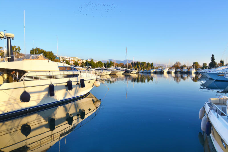 Boats at Alimos Attica Greece. Boat reflection on sea at Alimos Attica Greece royalty free stock image