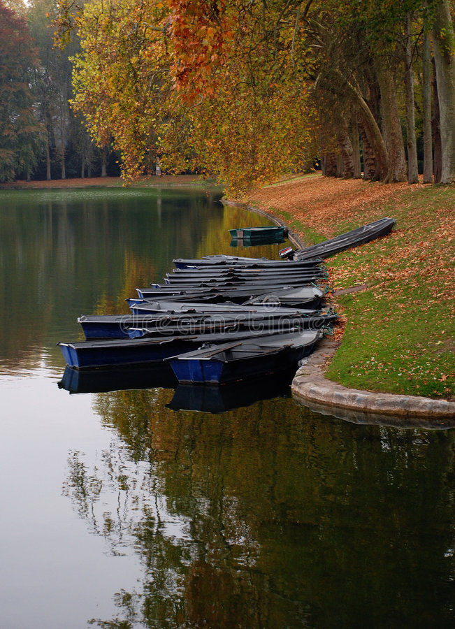 Download Boats Along River In Autumn Stock Photo - Image: 7928096
