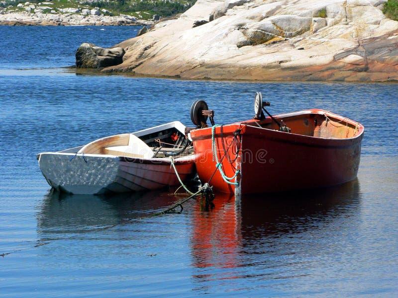 Boats anchored at bay over blue water royalty free stock photos