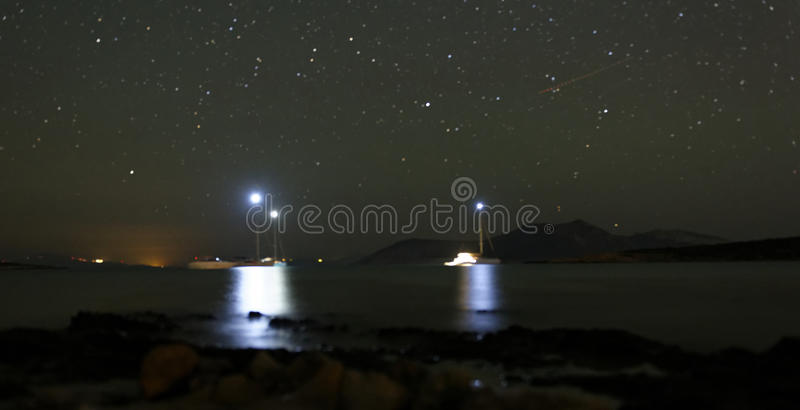 Boats anchored at night royalty free stock images