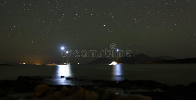 Boats anchored at night royalty free stock images