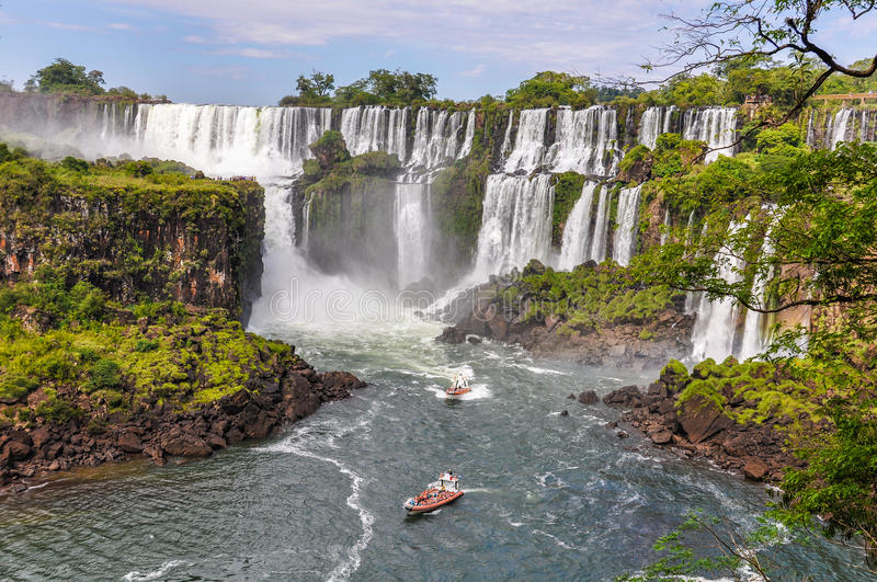 Boats around Iguazu Falls, Argentina royalty free stock image