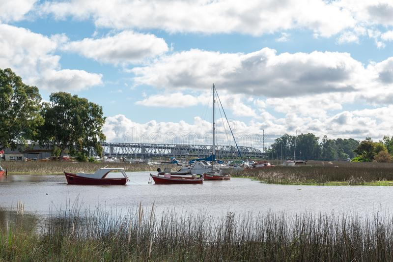 Boats on the banks of the river wetlands stock images
