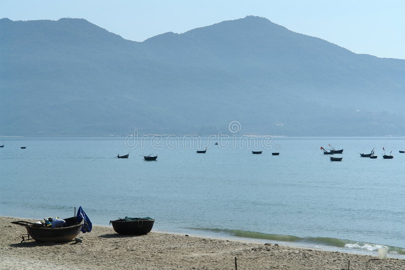 Boats in a bay with mountains royalty free stock photo