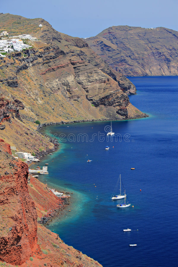 Boats in a bay on Santorini island royalty free stock images