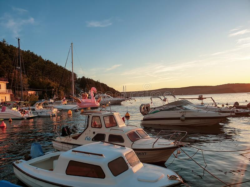 Boats in bay at sunset royalty free stock photos