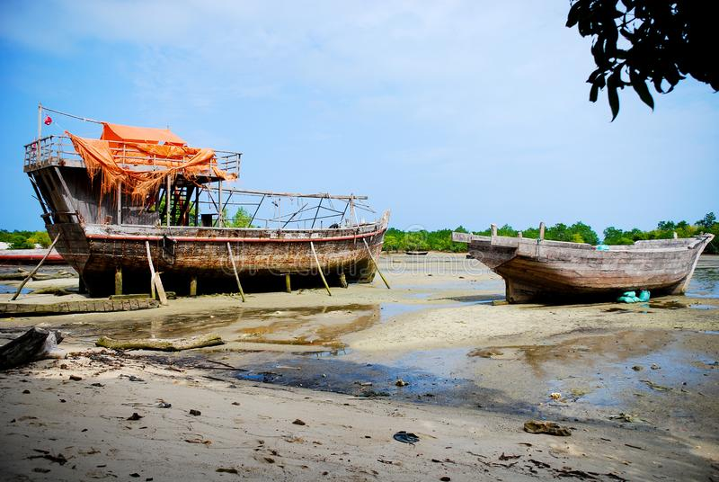 Boats on the beach. Two boats on the beach at low tide, Zanzibar, East Africa royalty free stock photography