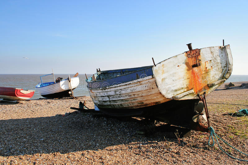 Download Boats Beached On A Shingle Beach Stock Image - Image: 28459583