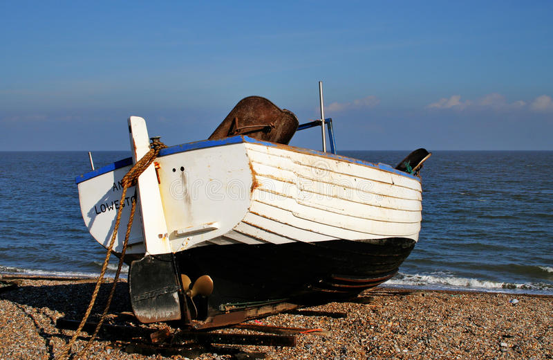Download Boats Beached On A Shingle Beach Stock Photo - Image: 28459610