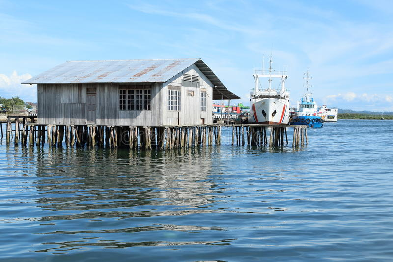 Boats behind a fishers house in Sorong stock images
