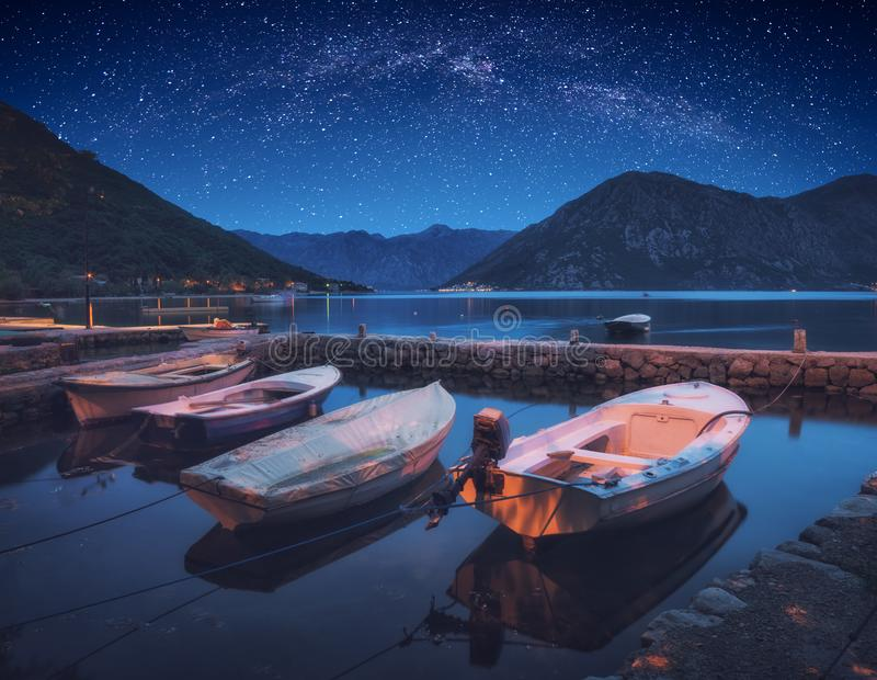 Boats in a Boka-Kotor bay under the night sky. Boats in a Boka-Kotor bay under the night starry sky. Adriatic sea, Montenegro, Europe stock image