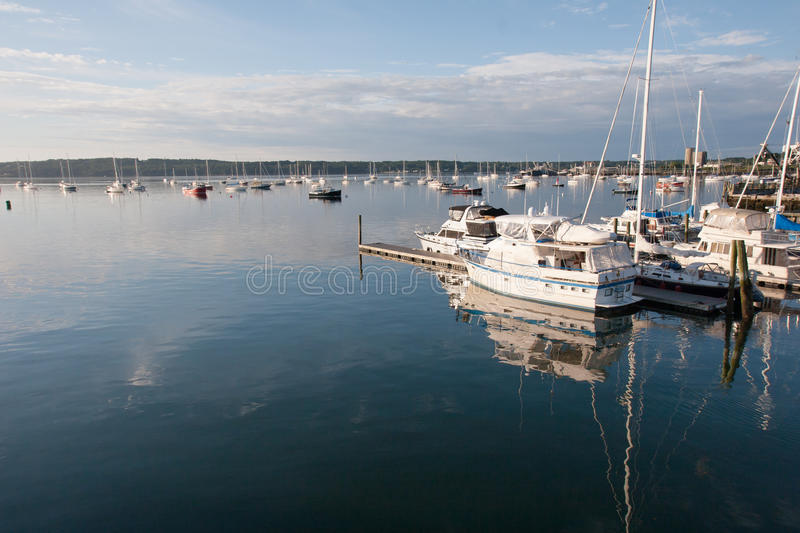 Boats in Boothbay Harbor. Scenic view of boats moored in Boothbay Harbor, Maine. Photo taken on August 1, 2010 royalty free stock photo