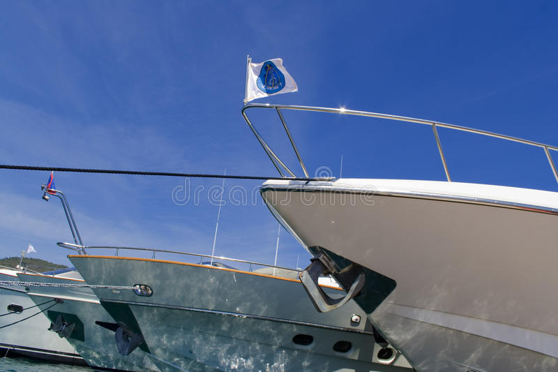 Download Boats bows stock photo. Image of flag, jetty, hulls, reflection - 14183574