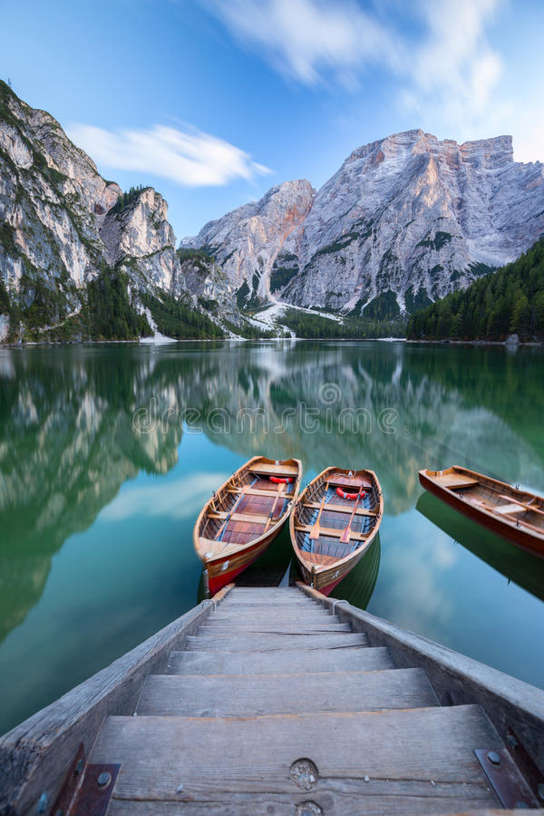 Boats on the Braies Lake Pragser Wildsee in Dolomites mounta royalty free stock photos