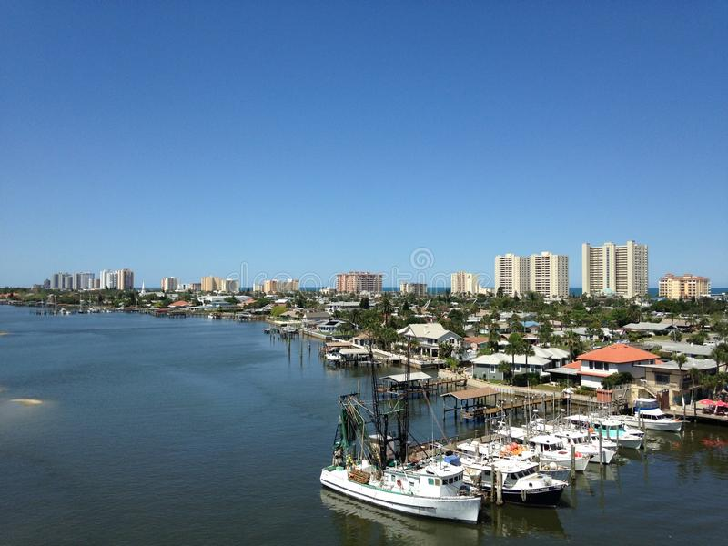 Boats and Buildings along Halifax River in Florida. royalty free stock photography