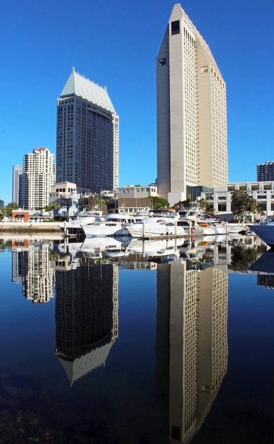 San Diego Bay, San Diego city skyline. The boats and the buildings are reflection on the water of the San Diego Bay, California royalty free stock image