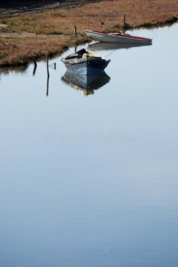 Boats on calm waters royalty free stock image