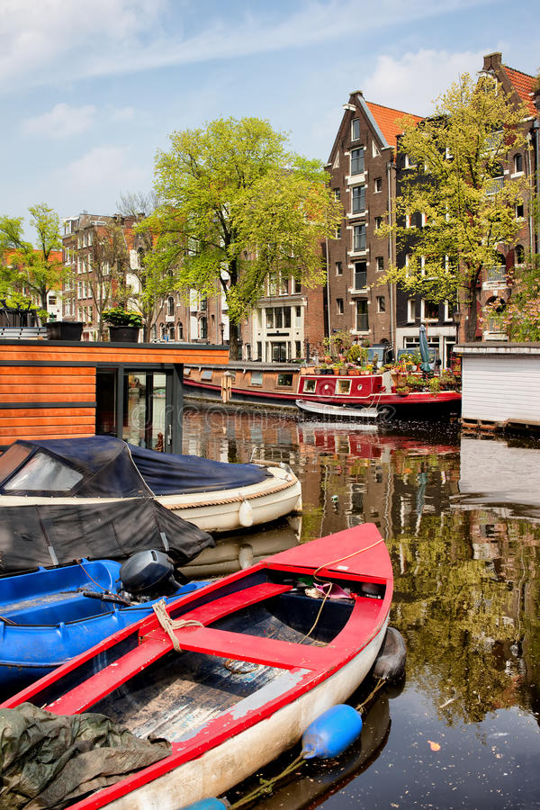 Boats on Canal in Amsterdam. Boats and historic apartment buildings along the Brouwersgracht canal (brewers canal) in Amsterdam, Netherlands, North Holland stock photos