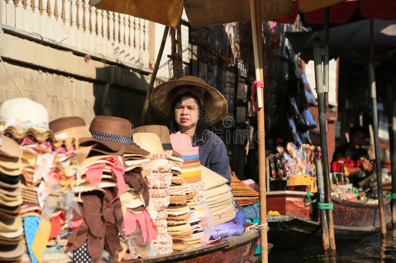 Bangkok Thailand. Boats on the canal selling hats and clothes for tourists in Damnoen Saduak floating market. royalty free stock image