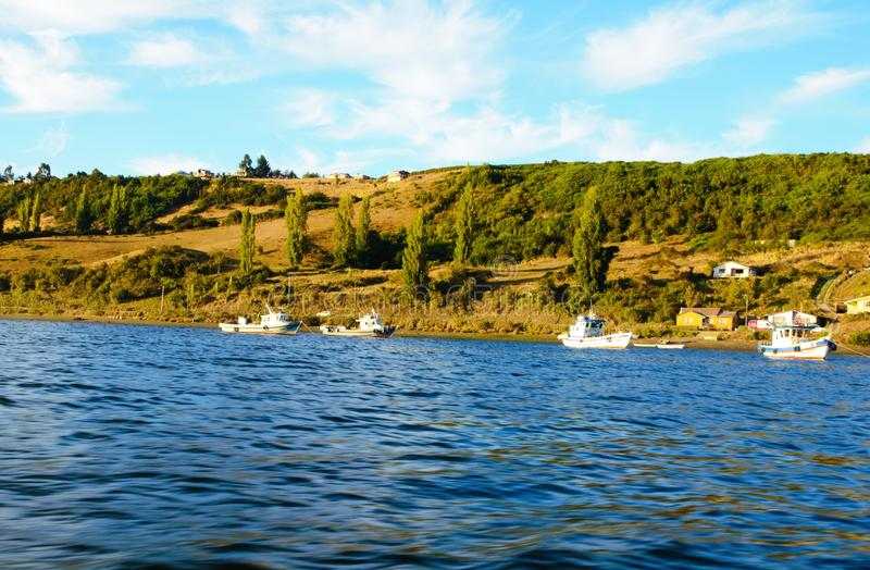 Boats in Castro. Boats on the water in Castro on the island Chiloé in Chile royalty free stock photo