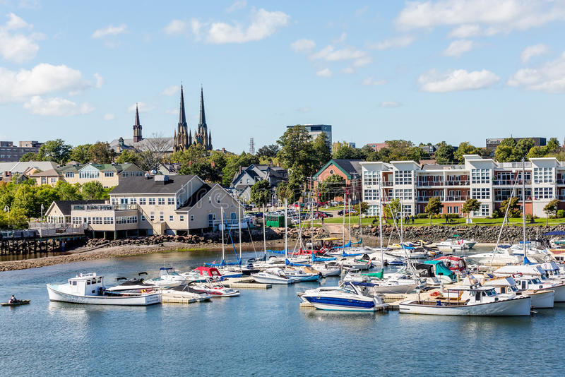 Boats in Charlottetown with Church. Fishing boats in harbor of Charlottetown, Prince Edward Island stock photography